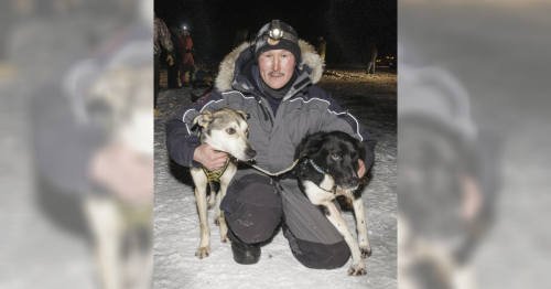 Greg Larson of Napaskiak poses with his lead dogs at the finish line after winning the 2016 Akiak Dash sled dog race. CREDIT CHRIS PIKE / KYUK