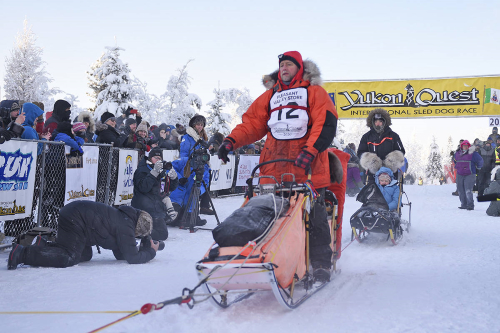 Rob Cooke starts the Yukon Quest with handler James Wilde steering the Quest Guest sled at the Morris Thompson Cultural and Visitors Center in Fairbanks, Alaska, on Feb. 1. (John Hopkins-Hill/Yukon News)